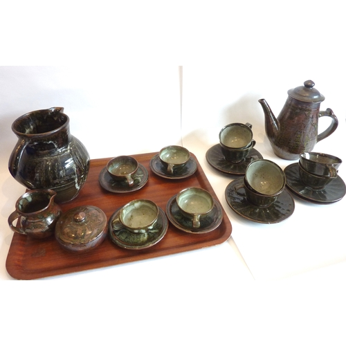 5 - A Studioware Art Pottery coffee service comprising cups and saucers, coffee pot, cream jug, one furt...