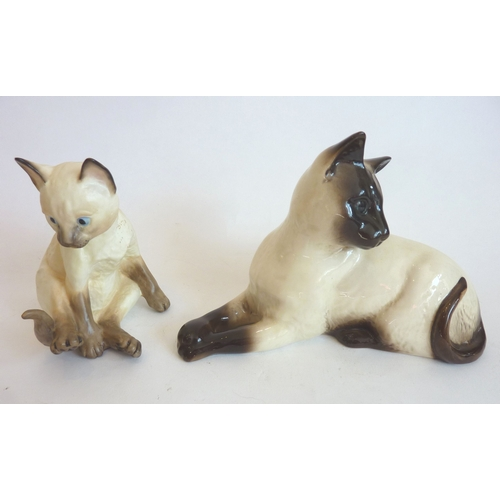 6 - A Beswick porcelain model of a recumbent cat with impressed printed marks and original label to unde...