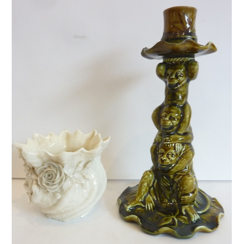 35 - An early Mintons 'Monkey' candlestick together with a Belleek vase...