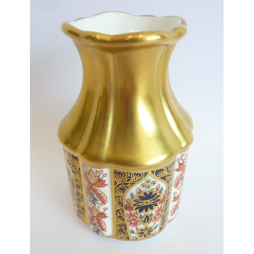 44H - A small royal Crown Derby porcelain 'Old Imari' vase in the 1128 pattern...