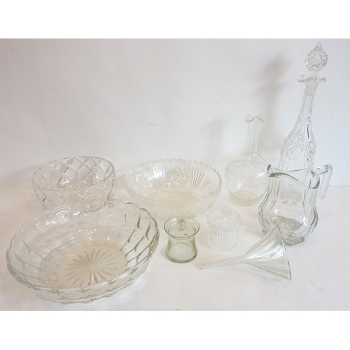 48 - A selection of glassware to include fruit bowls, a jug, a funnel and decanters...