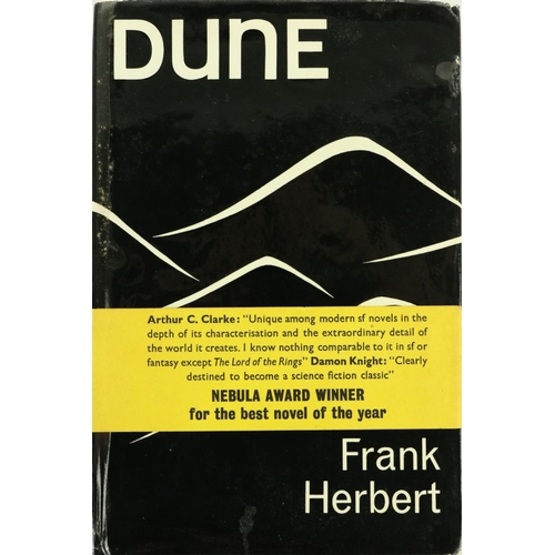 Very Rare First U.K. Edition with Yellow Paper Band  Herbert (Frank) Dune 8vo London (Victor Gollancz Ltd.) 1966. First Edn., hf. title, a little discolouration on fore-edges, with orig. black dust wrapper with white silhouette, somewhat bubbled at joints, and with the extremely rare yellow wrap-around with quotation from Arthur C. Clarke. An extremely good copy. (1) * A science fiction classic
