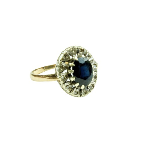 555 - <strong>An attractive Ladies oval shaped Ring,</strong> with large centre sapphire surrounded by sma...