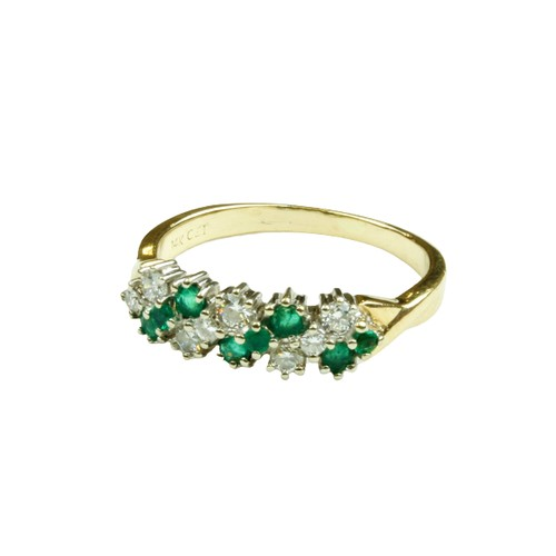 556 - <strong>A fine quality ladies Cluster Ring,</strong> with eight diamonds and emeralds of variant siz...