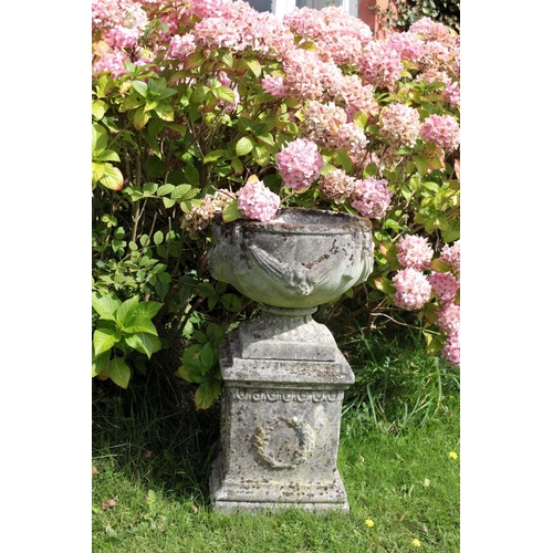 27 - A pair of attractive Victorian style composition Garden Urns on stands, decorated in the Adams taste...