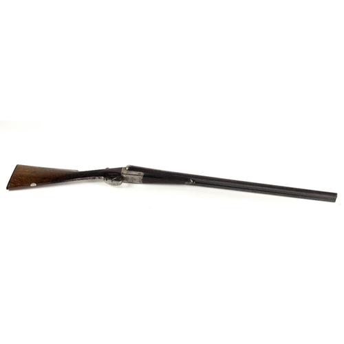 42 - An Irish 12 bore double barrel Shotgun, by Kavanagh, Dublin, Serial No. 65983, with scroll decoratio...