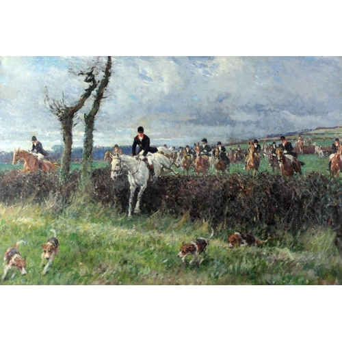 "Gilbert Holiday (1879 - 1937)""The Hunt at Woolwich Drag,"" O.O.C., with Brigadier Boylan M.F.H., leading the field, atmospheric busy hunting scene with hounds and figures on horseback in a vast landscape,"" approx. 51cms x 76cms (20"" x 30"") signed lower right in initials, in ornate gilt frame. (1)* Commissioned and Presented to Retiring Commander of the Riding Troop Brigadier Boylan. The Riding Troop is now known as The King's Troop Royal Horse Artillery."
