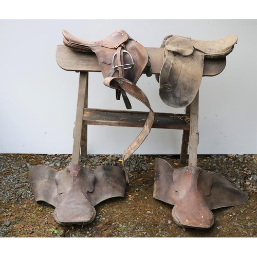 8 - Four varied leather Saddles, and a wooden Saddle Horse. (a lot).