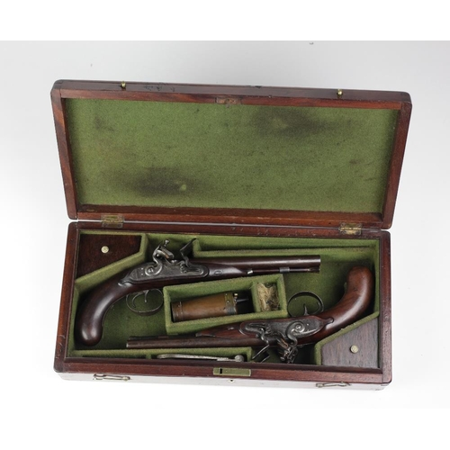 An important and fine pair of early 19th Century Coaching Pistols, by Bird & Ashmore of London, both with double barrels, engraved mechanism and trigger guard, both with mahogany handles and with consecutive West Cork Registration marks WC3051 & WC3052, in original mahogany cases, with powder flask and bullet mould. (2)