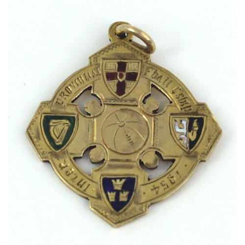 "1954 Railway Cup - Leinster WinnersMedal: G.A.A., Football, a 9ct gold cross shaped Medal with pierced decoration, the obverse with central football, each point with enamel design Provincial arms, inscribed around edge ""Inter-Provincial F'ball C'ship 1954', the reverse inscribed ""Cuige Laighean"" hall marked. (1)* Croke Park saw a record crowd of 49,023 spectators see Leinster claim the Football & Hurling Double in the Railway Cup"