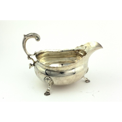 32 - A rare plain George II English silver Sauceboat, London c. 1755, maker possibly Henry Miller,  with ...