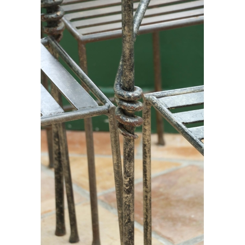 20 - <strong>A modern heavy wrought iron Patio Suite,</strong> consisting of circular table with glass to...