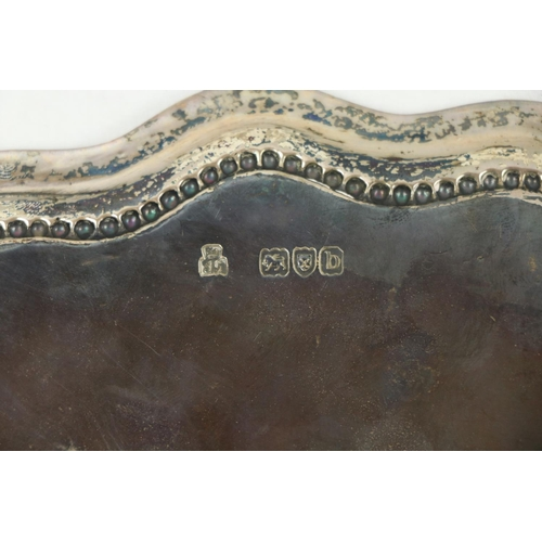 201 - A heavy silver London mark PresentationTray, with shaped beaded double edge, inscribed