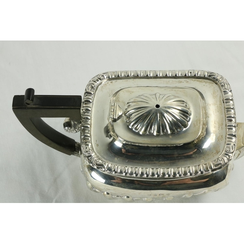 203 - A rectangularhalf reeded silver Teapot, with ebonised handle, Birmingham 1913, 572 grams. (1)...