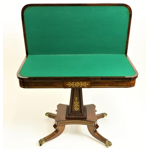 34 - <strong>An attractive Regency period fold-over rosewood and brass inlaid Card Table,</strong> on upw...