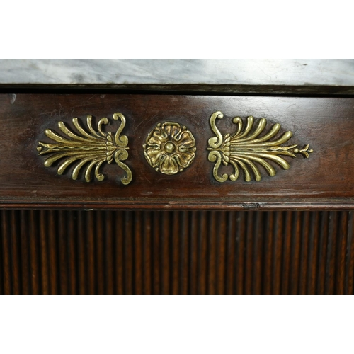 417 - A very fine pair of Regency mahogany Side Cabinets, applied with gilt metal mounts, each with an ass...