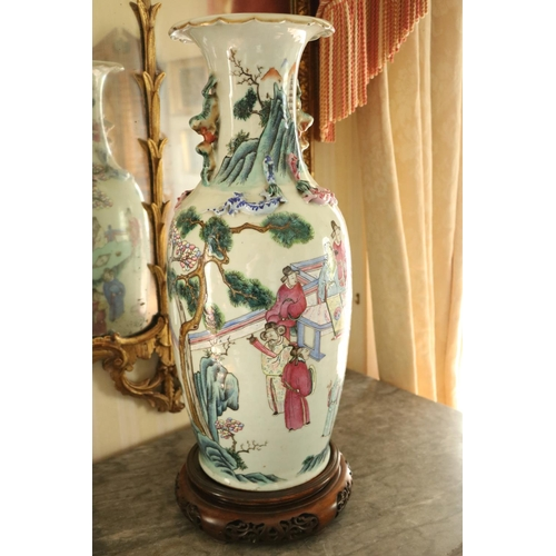 418 - A pair of attractive large 19th Century Cantonese Famille Verte Vases, each decorated with figures, ...