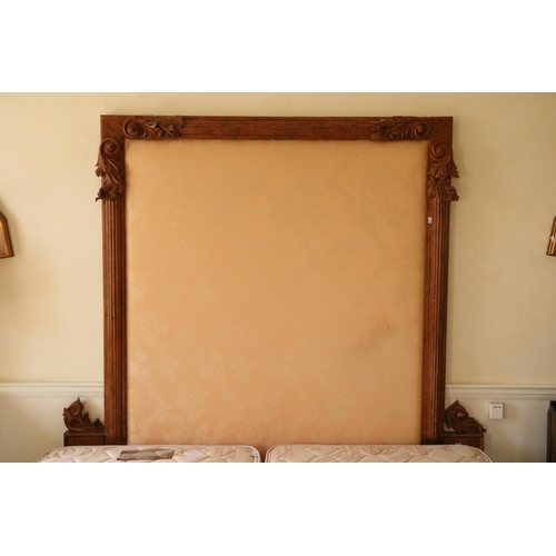 54 - <strong>A modern 6' Divan Bed,</strong> with double mattress, and a padded carved pollard oak headbo...