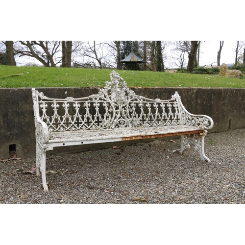 587 - An important heavypair of Victorian cast iron Garden Benches, each pierced back with a roundel...