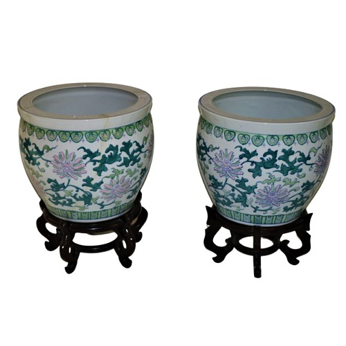 45 - <strong>A pair of large modern Chinese Fish Bowls,</strong> decorated with stylized flowers on hardw...