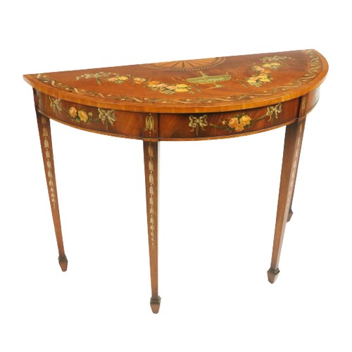 49 - <strong>A George III mahogany demi-lune Side Table,</strong> profusely decorated with a centre urn i...