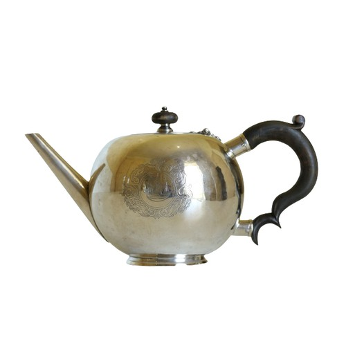 202 - A fine quality and rare Irish Georgian (George II period) silver bullet Teapot,the hinged circular ...