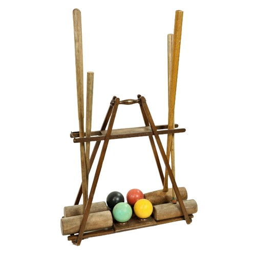 12 - <strong>The 'Ilsborne' Croquet Carrier Stand,</strong> made by F.H. Ayres of London, with four malle...