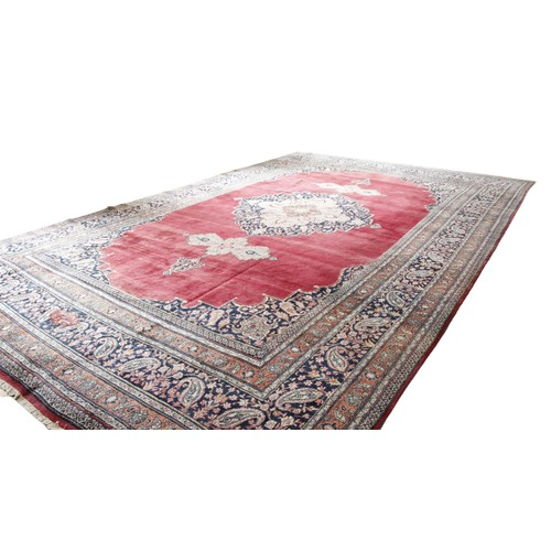 476 - A fine semi-antique burgundy ground Persian Carpet, the large centre medallion with stylized flowers...