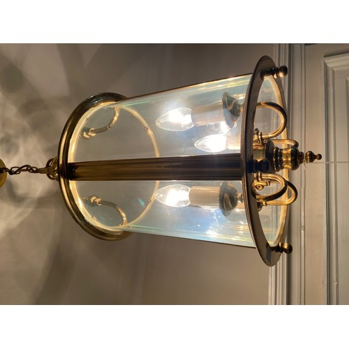 42 - <strong>A Georgian style brass Hall Lantern,</strong> with domed glass and shaped supports, 2' high ...