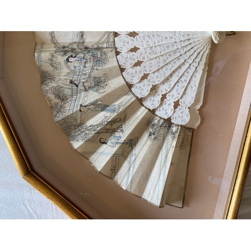 52 - <strong>A 19th Century Chinese Fan,</strong> with carved and pierced ivory sticks, the silk leaves d...