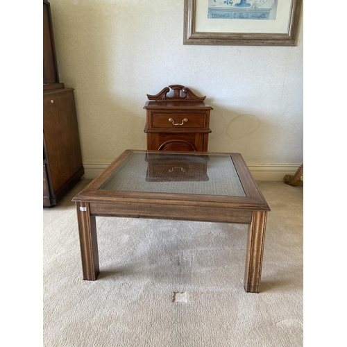 10 - A Regency style three drawer mahogany Dressing Table, raised on reeded standards and four sabre legs...
