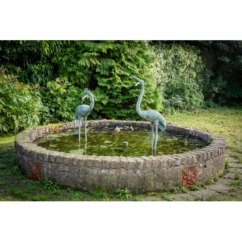 115 - A fine pair of cast bronze Fountain or Pond Figures, modelled as standing Flamingos, one facing forw...
