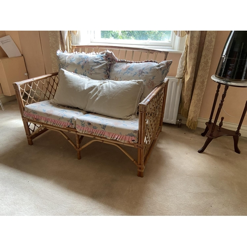 4 - A three piece Suite of wicker work Seat Furniture, comprising a two seater Settee and a pair of Armc...