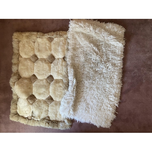 51 - Three faux sheep wool Rugs, and two similar Cushions and a colourful floral Print. (5)...