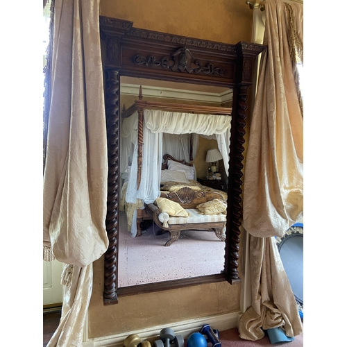 60 - WITHDRAWN..A late 19th Century carved oak Pier Mirror, of inverted breakfront outline with cartouch...