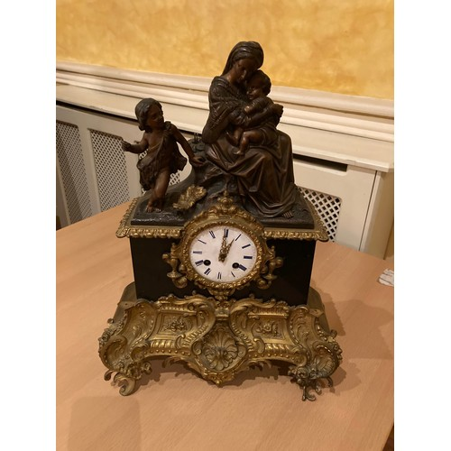 239 - A French gilt metal mounted and polished black marble Mantle Clock, with silk suspension movement an...