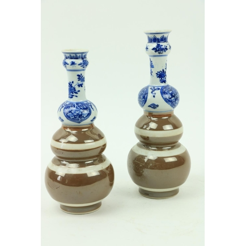 30 - Two similar Xiangshi period (1663 - 1728) triplegourd blue and white Caféau Lait Vases, with flora...