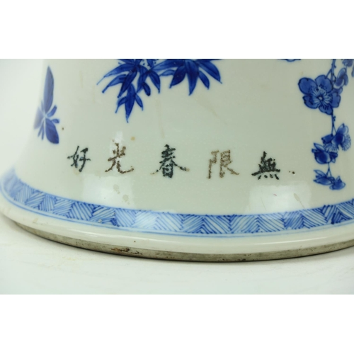 46 - A large important Kangxi period blue and white Gu Vase, 18th Century, decorated with birds and flowe...
