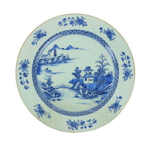 43 - A large circular blue and white Kangshi Charger, with pagodas and residences, and with a figure in ...