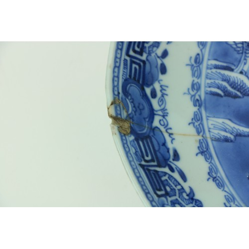 35 - A pair of Kangshi blue and white Chinese porcelainDishes, each decorated with figures and residence...