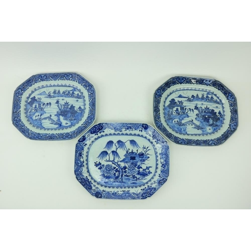 32 - A pair of Nankin blue and white Meat Platters, decorated with figures and residents by a lake; anoth...