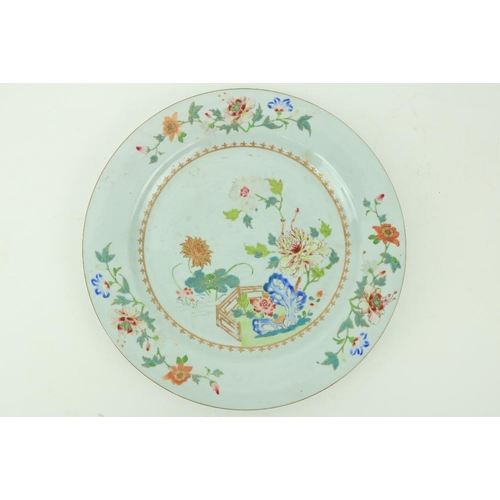 42 - An 18th Century Chinese Famille Rose Platter, decorated with colourful flowers, with fleur de lys gi...
