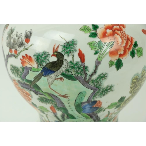 47 - A very fine 18th Century Famille Rose baluster shaped Jar and Cover, decorated with colourful flower...