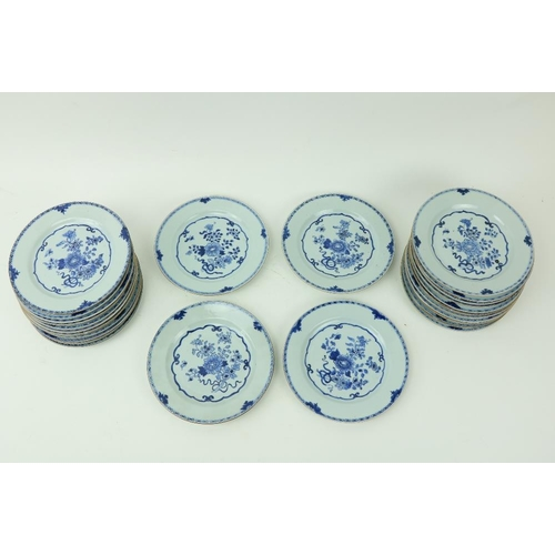55 - A very good set of 28 Chinese blue and white Plates, 18th Century, each decorated with flowers insi...