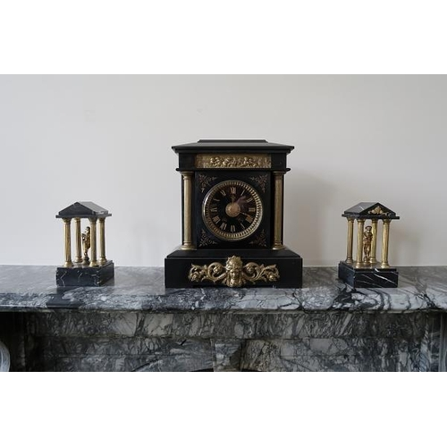 13 - A matched Victorian architectural style three piece clock garniture, 41 cms high....