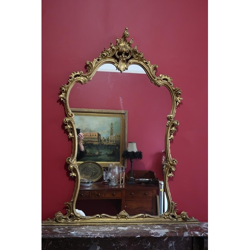 15 - A mid century Rococco style gilt overmantle, 143 cms high, 118 cms wide....