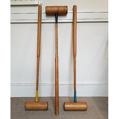 17 - Three croquet mallets.