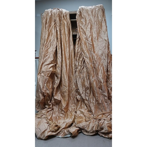 24 - A pair of gold silk curtains, 90 wide, 325 long with tassles....