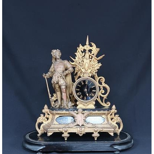 44 - A Louis Philippe revival brass mantle clock with ebonised face and flanking standing figure of a mus...