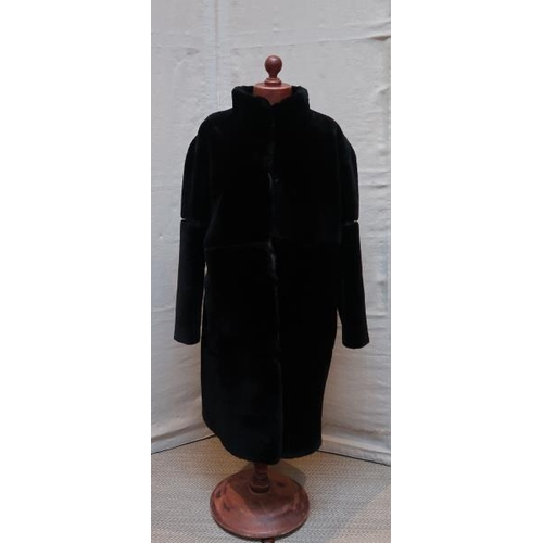 47 - A black faux fur coat,Retailer Sprung Freres Paris, 102 cms long....